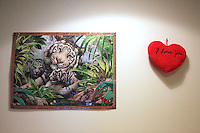 A cardboard-framed jigsaw puzzle Lucinda made in Jelling asylum center while she was pregnant with David hangs on the wall in their room at Sandholm accommodation center.<br /> They have the same eyes as my David,&quot; she said.