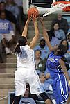 26 February 2012: North Carolina's Chay Shegog (20) shoots over Duke's Elizabeth Williams (1). The Duke University Blue Devils defeated the University of North Carolina Tar Heels 69-63 at Carmichael Arena in Chapel Hill, North Carolina in an NCAA Division I Women's basketball game.