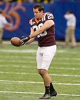 Scott Demier of Virginia Tech warms up before Sugar Bowl game against Michigan at Mercedes-Benz SuperDome in New Orleans, Louisiana on January 3rd, 2012.  Michigan defeated Virginia Tech, 23-20 in first overtime.
