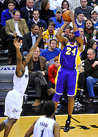 Lakers' Kobe Bryant buries a 3-pointer shot over Gilbert Arenas of the Wizards. Los Angeles defeated Washington 103-89 at the Verizon Center in Washington, DC on Tuesday, December 14, 2010. Alan P. Santos/DC Sports Box