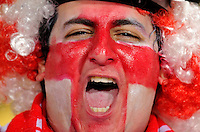 An England fan cheers. USA vs England in the  2010 FIFA World Cup in Rustenburg, South Africa on June 12, 2010.
