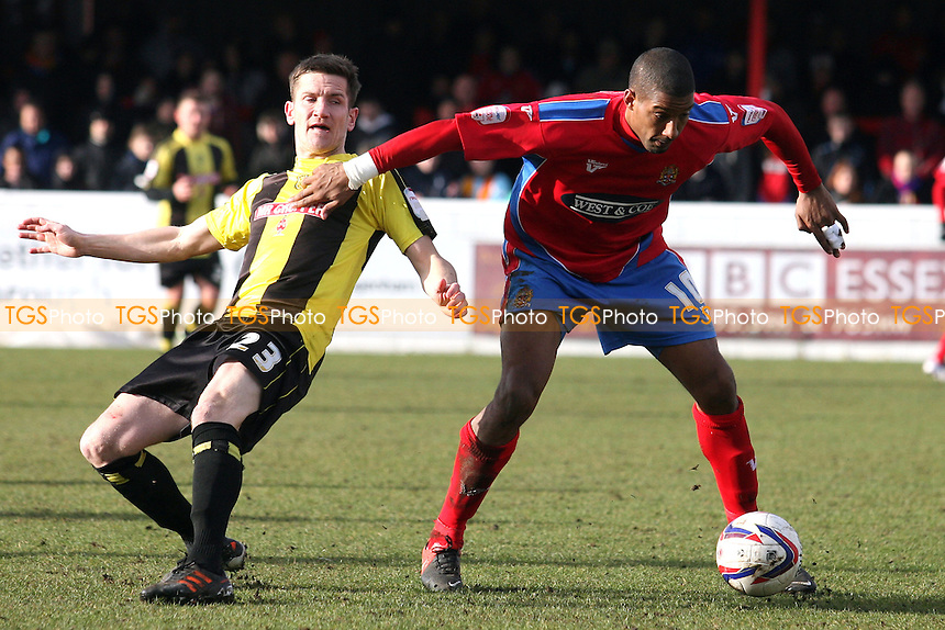 Lee Bell of Burton Albion and Josh Scott of Dagenham - Dagenham and Redbridge vs Burton Albion at the London Borough of Barking and Dagenham Stadium - 16/03/13 - MANDATORY CREDIT: Dave Simpson/TGSPHOTO - Self billing applies where appropriate - 0845 094 6026 - contact@tgsphoto.co.uk - NO UNPAID USE.