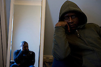 """34 year old Alain sits at a friends house in Walthamstow, London. After fleeing DR Congo and claiming asylum in the UK in 2002 he spent months destitute. His work as a TV journalist led to his arrest and torture by government soldiers in DR Congo, and only after paying a huge bribe was he able to escape and flee the country. If he returns he believes he will be killed. His asylum claim was refused, and unnable to work or support himself, he began sleeping rough in the Elephant and Castle area of London. He is completely destitute and struggles to survive, depending on a friend who is also a refused asylum seeker but who has support from section 4 of the Immigration and Asylum Act 1999 (no choice of accommodation and GBP 35 of supermarket vouchers a week). Two years ago Alain was the victim of a racist attack, when a white man blinded him in one eye with a piece of broken glass. """"As asylum seekers we have been punished twice - once back home and once here. In Kinshasa I was tortured physically and here I'm tortured mentally. I've transferred from one prison to another."""" Alain is one of an estimated 300,000 rejected asylum seekers living in the UK. ."""