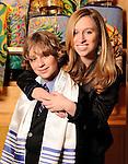 Bar Mitzvah boy and his older sister with the Torahs at CSI Synagogue, Briarcliff Manor, New York.