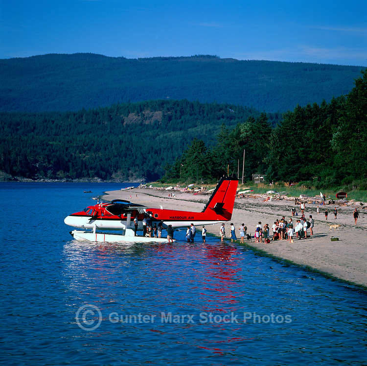 "Savary Island, Northern Gulf Islands, BC, British Columbia, Canada - Families waiting for Arrival of Fathers on ""Daddy Plane"", on Beach overlooking Georgia Strait, Pacific Ocean"