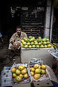 Traders buy and sell different varieties of mangoes in the wholesale market, Ch. Hira Singh Fruits and Vegetable Market in Azadpur, Delhi, India. Photo: Sanjit Das/Panos