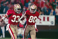 SAN FRANCISCO, CA - Roger Craig, left, and Jerry Rice of the San Francisco 49ers celebrate during a game at Candlestick Park in San Francisco, California in 1989. Photo by Brad Mangin