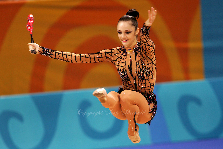 August 29, 2004; Athens, Greece; Rhythmic gymnastics star ANNA BESSONOVA of Ukraine (here performing Cossack jump with clubs) wins bronze in All-Around at 2004 Athens Olympics.<br /> (&copy;) Copyright 2004 Tom Theobald