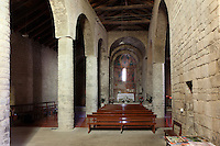 Nave looking towards the central apse with mural paintings (replicas) depicting the Virgin and Child with the Magis and window of Santa Maria de Taull Church, 1123, consecrated by Ramon Guillem, the bishop of Roda, Taull, Province of Lleida, Catalonia, Spain. The church was built with three naves, each ending with an apse. It was heavily renovated in the 18th century. Its frescoes were removed to the MNAC (National Art Museum of Catalonia, Barcelona) circa 1918. Santa Maria de Taull Church is part of the Catalan Romanesque churches of the Vall de Boí which were declared a World Heritage Site by UNESCO in November 2000. Picture by Manuel Cohen