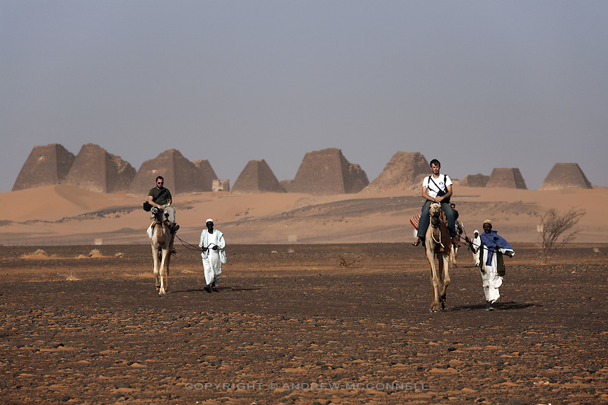 Tourists take camel rides from the pyramids of Meroe, Sudan's most popular tourist attraction, pictured on Saturday, March 31, 2007. The old Kushite capital of Meroe contains around 100 pyramids in various states of preservation. The earliest date from around the 8th century BC, Kings and Queens continued to be buried here until the fall of Kushite rule in the 4th century AD...The ancient kingdom of Kush emerged around 2000 BC in the land of Nubia, what is today northern Sudan. At their height the Nubians ruled over ancient Egypt as the 25th Dynasty between 720 BC and 664 BC (known as the Black Pharaohs) and saw their borders reach to edges of Libya and Palestine. The Kushite kings saw themselves as guardians of Egyptian religion and tradition. They centered there kindgom on the Temple of Amun at Napata (modern day Jebel Barkal) and brought back the building of Pyramids in which to inter their kings - there are around 220 pyramids in Sudan, twice the number in Egypt. After Napata was sacked, by a resurgent Egypt, the capital was moved to Meroe where a more indigenous culture developed, Egyptian hieroglyphics made way for a cursive Meroitic script, yet to be deciphered. The Meroitic kingdom eventually fell into decline in the 3rd century AD with the arrival of Christianity.