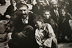 Photographs of Roma and Sinti Holocaust victims in concentration camp. Germany..The Deportation of Jews, Roma and Sinti in Hamburg 1940-45. Roma and Sinti Holocaust survivors. Conference and exhibition. Roma Holocaust &quot;Porrajmos&quot;, the Roma word means literally &quot;the devouring&quot;, where it is estimated that between 500 thousand and one and a half million Roma were exterminated across Germany, Poland, ex-Yugoslavia and Czechoslovakia during the 1930s and 1940s. The Roma were the first race to be subjected to experimentation by the Nazis, as part of Joseph Goebbels' 'Final Solution'.