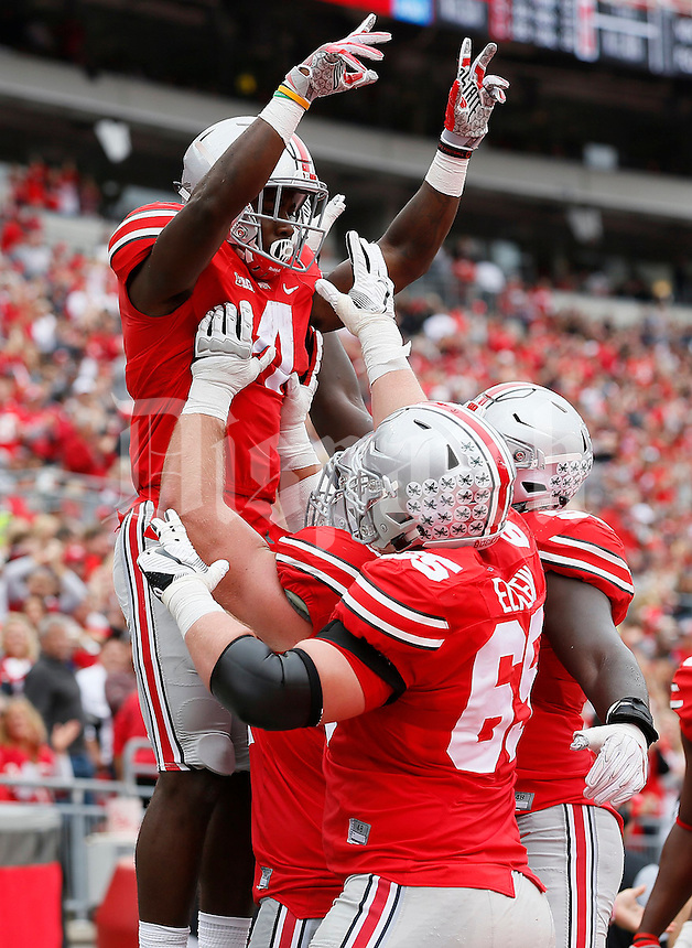Ohio State Buckeyes offensive linemen lift running back Curtis Samuel (4) after he scored a touchdown during the first half of the NCAA football game at Ohio Stadium in Columbus on Oct. 1, 2016. (Adam Cairns / The Columbus Dispatch)