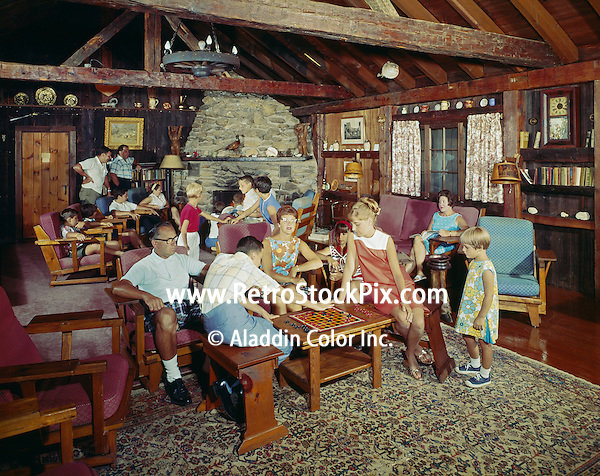 Twin Bay Village in Lake George NY - 1963 Families enjoying the fireplace lounge