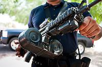Heavily armed police at El Maviri island outside of Los Mochis, Sinaloa, Mexico. Aromas y Sabores with Chef Patricia Quintana