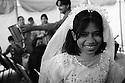 A girl in festive clothes is attending a wedding ceremony in the French Colony slum. This quarter in the heart of Islamabad is inhabited by the Christian minority of the city, living in poor conditions lacking basic neccesities like sanitation. 2009