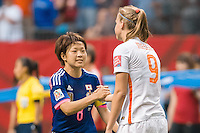 June 23, 2015: Aya MIYAMA of Japan and Vivianne MIEDEMA of Netherlands shake hands after the end of a round of 16 match between Japan and Netherlands at the FIFA Women's World Cup Canada 2015 at BC Place Stadium on 23 June 2015 in Vancouver, Canada. Japan won 2-1. Sydney Low/AsteriskImages.com