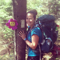 Courtesy photo/KRISTEN LEWIS<br /> Kristen Lewis on the Appalachian Trail with her hiking mascot, Gideon, a flower that was a present from her mom. Lewis spent six month hiking the entire trail, covering 2,189.2 miles.
