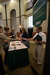 Breanna Sisler (left) and Carly Cecil (right) hand out the participant's alternate personalties that they will be acting as to help faculty and staff further understand The Ohio Gaurantee. Photo by Katelyn Vancouver