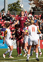 COLLEGE PARK, MD - OCTOBER 21, 2012:  Defenders of the University of Maryland watch Kristin Grubka (13) of Florida State head the ball during an ACC women's match at Ludwig Field in College Park, MD. on October 21. Florida won 1-0.