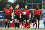 15 August 2014: Match officials. From left: Assistant referee Brian Saucedo, Fourth Official Robert Dail, Referee David Erbuche, and Assistant referee Raymond Thomas. The University of North Carolina Tar Heels hosted the Gardner-Webb University Bulldogs at Fetzer Field in Chapel Hill, NC in a 2014 NCAA Division I Men's Soccer preseason match. North Carolina won the exhibition 7-0.