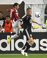 Danny Allsopp #9 of D.C. United is tackled from behind by Mariano Trujillo #8 of Chivas USA during an MLS match at RFK Stadium, on May 29 2010 in Washington DC. United won 3-2.