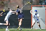 DURHAM, NC - FEBRUARY 26: Notre Dame's Molly Cobb (22) scores a goal past Duke's Jamie Lockwood (32). The Duke University Blue Devils hosted the University of Notre Dame Fighting Irish on February, 26, 2017, at Koskinen Stadium in Durham, NC in a Division I College Women's Lacrosse match. Notre Dame won the game 12-11.