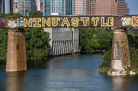 """Austin has a rich heritage of public art murals such as the """"I've Got NINJA STYLE"""" is a fun and catchy graffiti mural painting on the Austin Railroad Graffiti Bridge over Lady Bird Lake, Austin, Texas."""