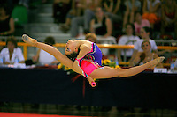 Silvia Gonzales of Spain split leaps with clubs during junior All-Around competition at 2006 Trofeo Cariprato in Prato, Italy on June 17, 2006.  (Photo by Tom Theobald)