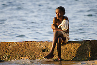 A child sitting on the beach at Mussulo