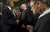 United States President Barack Obama greets U.S. Supreme Court Justice Anthony Kennedy (C) alongside Justice Ruth Bader Ginsburg (R) prior to his State of the Union address in front of a joint session of Congress on Tuesday, January 24, 2012 at the US Capitol in Washington, DC.  .Credit: Saul Loeb / Pool via CNP