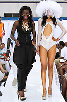 Fashion designer walks runway with model at the close of the Marseille Fashion swimsuit by Nabu & David, during the JRG Bikini Under The Bridge 2012 fashion show on July 9, 2012.