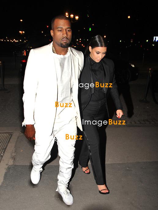 Kim Kardashian ( pregnant ) & Kanye West attend the Givenchy fFall/Winter 2013 Ready-to-Wear Fashion Show during Paris fashion week, on March 3, 2013.