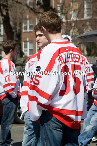 Corey Trivino (BU - 9), Grant Rollheiser (BU - 35) - Boston University celebrated the Terrier's men's hockey national championship win with a parade starting from a parking lot at Commonwealth Avenue and Deerfield running to BU's Marsh Plaza where the Terriers were honored on stage before mingling with the fans.