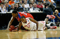 Ohio State Buckeyes forward Sam Thompson (12) and Dayton Flyers forward Dyshawn Pierre (21) dive for a loose ball in the second half of the second-round NCAA Tournament game between the Ohio State Buckeyes and the Dayton Flyers at the First Niagara Center, Thursday afternoon, March 20, 2014. The Dayton Flyers defeated the Ohio State Buckeyes 60 - 59. (The Columbus Dispatch / Eamon Queeney)