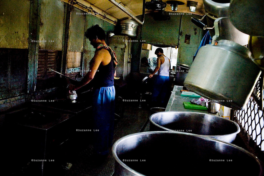 Workers cook lunch in the Pantry Car of the Himsagar Express 6318 on 7th July 2009.. .6318 / Himsagar Express, India's longest single train journey, spanning 3720 kms, going from the mountains (Hima) to the seas (Sagar), from Jammu and Kashmir state of the Indian Himalayas to Kanyakumari, which is the southern most tip of India...Photo by Suzanne Lee / for The National
