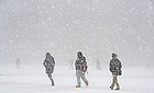 Jan. 31, 2013; Students walk across South Quad during a snow shower.  Photo by Barbara Johnston/University of Notre Dame