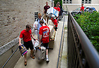 August 17, 2012; Members of the Zahm Hall orientation staff help with move in.  Photo by Barbara Johnston/University of Notre Dame