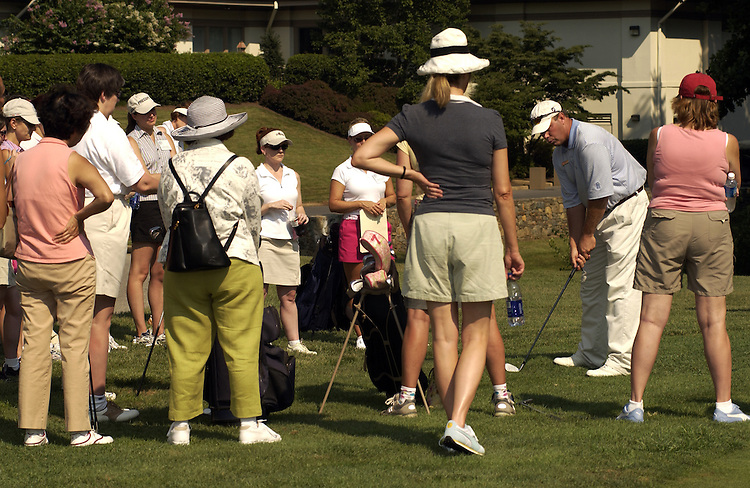 "A group of female lobbyist listen to Fran Rhoads, directer of instruction during the Women's Networking Forum"" to learn how to play golf at the Tournament Players Club in Potomac Maryland. It's no secret that rich white males transact a lot of business on the golf course. It's also no secret that women who don't play golf may be missing out on key opportunities to interact with clients and colleagues."