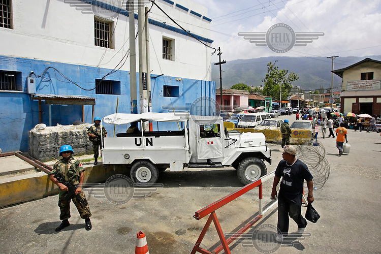 Peruvian UN peacekeeping soldiers from MINUSTAH (United Nations Stabilization Mission in Haiti) guard a prison.