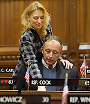 HARTFORD, CT- 07 JANUARY 2008 --010709JS01-Rep. Michelle L. Cook, D-Torrington, shows off her new seat in the CT General Assembly to her father Gene &quot;Gus&quot; Loness during the opening day of the legislative session Wednesday at the state Capitol in Hartford. Her father came in from St. Louis, MO for the swearing-in ceremony. <br /> Jim Shannon / Republican-American
