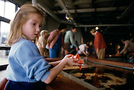 December 11, 1984 - Monterey Bay, California. Child holds Starfish at the Monterey Bay Aquarium. The Monterey Bay Aquarium, located on Cannery Row of the Pacific Ocean in Monterey California, was founded in 1984 and holds thousands of plants and animals. The annual attendance of the aquarium is 1.8 million visitors.