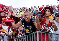 A New York Red Bulls fan yells to his team after a Major League Soccer game at PPL Park in Chester, PA.  Philadelphia defeated New York, 3-0.