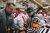 Jean-Yves Roy disposes of his gum in John O'Donnell's (Harvard - Equipment Manager) hand. - The visiting Boston College Eagles defeated the Harvard University Crimson 5-1 on Wednesday, November 20, 2013, at Bright-Landry Hockey Center in Cambridge, Massachusetts.