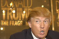 CHICAGO, Il- DEC 7, 2004: Real estate mogul Donald Trump makes an appearance at Chicago's Marshall Field's on State street to promotes his new cologne, The Fragrance.