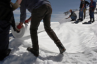 Workers unwrapped rolls of the material and attached it to the top of the part of the glacier.  Brunnenkogel Ferner--(Austrian word for glacier )is being wrapped with a fleece-like cover to keep it from melting.  The parts covered melt slower than if not covered. The ski area at 3,400 meters is covered by the thirteen workers to help save the ski industry since the glacier is retreating.  The cost of materials is one Euro per square meter.<br /> The Alpine glaciers -- in Austria, Switzerland, France and Italy -- are losing one percent of their mass every year and, even supposing no acceleration in that rate, will have all but disappeared by the end of the century...More hot, dry summers like that of 2003 in Europe, when the loss speeded to five percent, could cut the life expectancy to no more than 50 years, according to Wilfried Haeberli of the University of Zurich.<br /> &quot;We estimate that by the end of the 21st century, with a medium-type climate scenario, about five percent of what existed in the 1970s will have survived, he added.