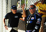 May 6, 2012; Commerce, GA, USA: NHRA top fuel dragster driver Brandon Bernstein (right) talks with J.R. Todd during the Southern Nationals at Atlanta Dragway. Mandatory Credit: Mark J. Rebilas-