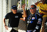 May 6, 2012; Commerce, GA, USA: NHRA top fuel dragster driver Brandon Bernstein (right) talks with J.R. Todd during the Southern Nationals at Atlanta Dragway. Mandatory Credit: Mark J. Rebilas-