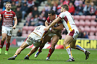 Wigan Warriors' Ben Flower is tackled by Huddersfield Giants' Sam Rapira and Paul Clough <br /> <br /> Photographer Stephen White/CameraSport<br /> <br /> Betfred Super League Round 5 - Wigan Warriors v Huddersfield Giants - Sunday 19th March 2017 - DW Stadium - Wigan<br /> <br /> World Copyright &copy; 2017 CameraSport. All rights reserved. 43 Linden Ave. Countesthorpe. Leicester. England. LE8 5PG - Tel: +44 (0) 116 277 4147 - admin@camerasport.com - www.camerasport.com