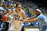 03 March 2013: Duke's Haley Peters (33) and North Carolina's Brittany Rountree (right). The Duke University Blue Devils played the University of North Carolina Tar Heels at Cameron Indoor Stadium in Durham, North Carolina in a 2012-2013 NCAA Division I and Atlantic Coast Conference women's college basketball game. Duke won the game 65-58.