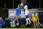 30 November 2013: UCLA's Courtney Proctor (left) and North Carolina's Satara Murray (right) challenge for a header. The University of North Carolina Tar Heels played the University of California Los Angeles Bruins at Fetzer Field in Chapel Hill, North Carolina in a 2013 NCAA Division I Women's Soccer Tournament Quarterfinal match. UCLA won the game 1-0 in two overtimes.